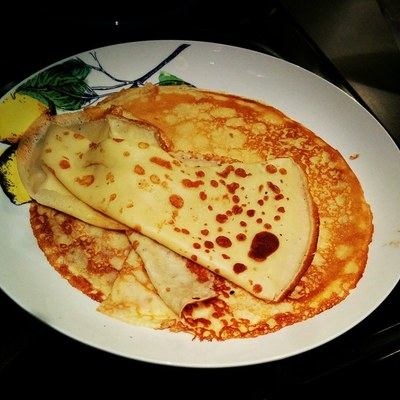 Plate full of savoury crepes made of refined wheat flour