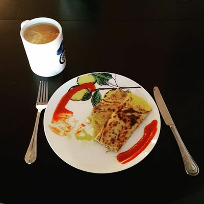 The perfect crepe breakfast with Gruyère cheese and Sriracha sauce and coffee