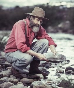 Old geezer panning for Bitcoin